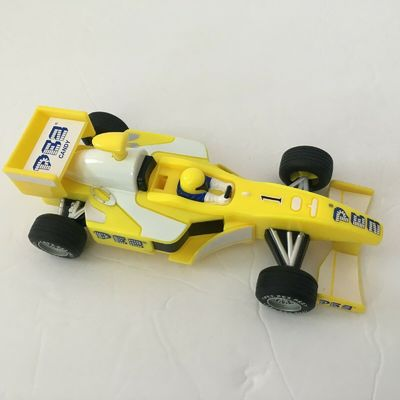 Yellow Pez Dispenser Formula one Indy Style Race Car Pull n Go Action
