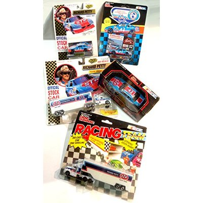 Richard Petty NASCAR diecast group lot including Two 1/87 haulers; Two 1/64 Stock Cars & a 1/43 scale Stock car
